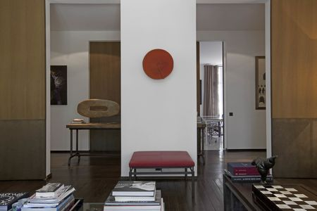 A red hat from Indonesia hangs on a wall that leads to the gallery.