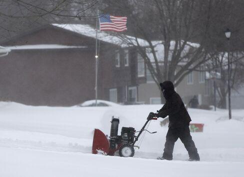 A resident plowing snow on Dec. 28, 2015 in Waterloo, Iowa.