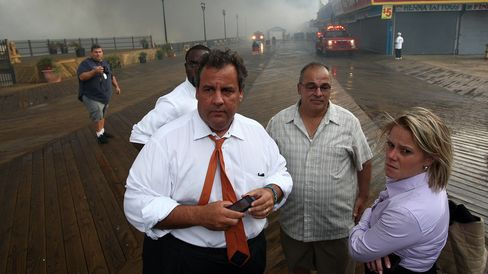 In this handout provided by the Office of the Governor of New Jersey, Governor Chris Christie tours a fire area with then-deputy chief of staff Bridget Anne Kelly and Office of Emergency Management personnel on Sept. 12, 2013, in Seaside Heights, New Jersey.