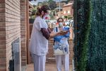 Field researchers disinfect their hands as they depart the home of a Covid-19 positive patientin Sant Antoni de Vilamajor, Spain.