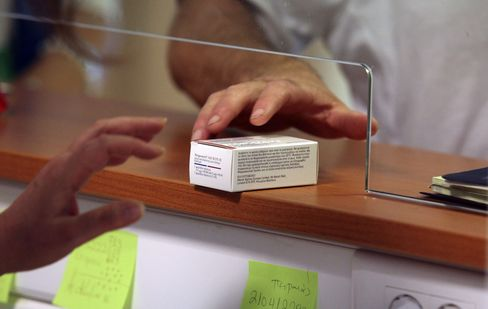 A Patient Collects Pharmaceutical Drugs in Athens