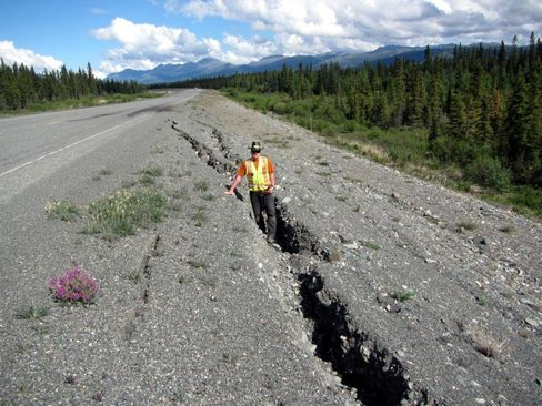 Paul Murchison, director of transportation engineering at the Yukon Department of Highways and Public Works, stands inside a rift caused by permafrost melting.