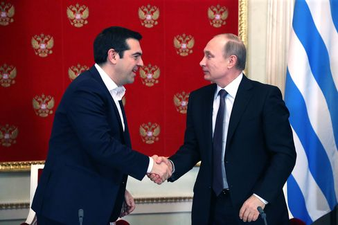 Russian President Vladimir Putin greets Greek Prime Minister Alexis Tsipras at the Kremlin during their joint press conference on April 8, 2015 in Moscow.