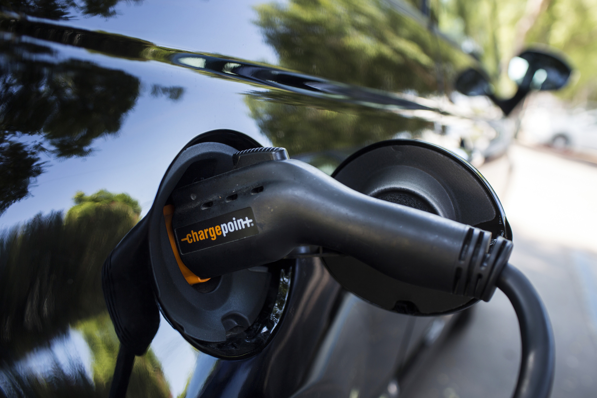 A ChargePoint Inc. charging plug sits connected to an electric vehicle at a station in Los Angeles, California.