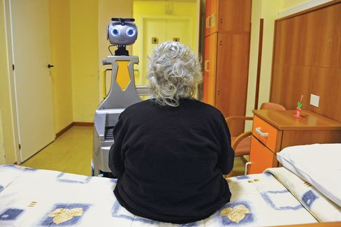 A robot being tested by Robot-Era has been programmed to accompany a woman to the dining room at a nursing home inFlorence.