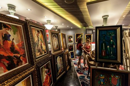 An afternoon art auction aboard the ship.