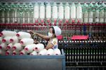 A worker manufactures cotton yarn at a factory in Dali county, Shaanxi province, China, on Wednesday, April 27, 2011.