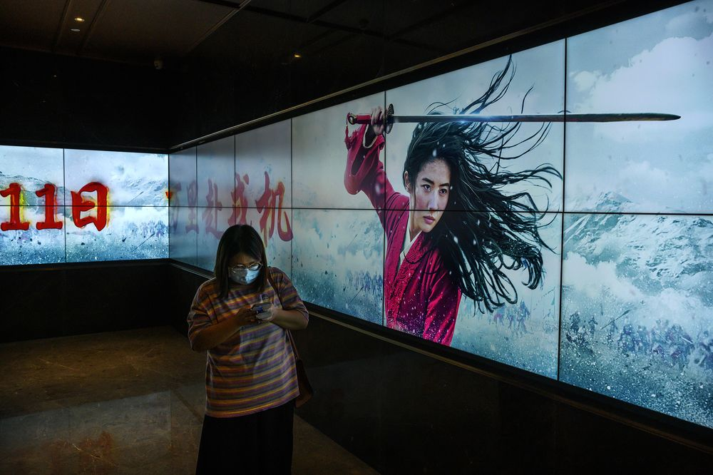 A screen displays the trailer for Mulan at a cinema in Beijing, China on Sept. 11.