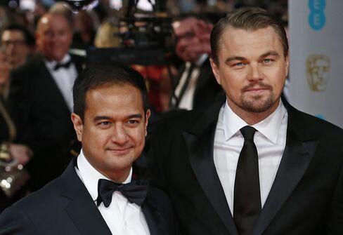 Riza Aziz, left, and Leonardo DiCaprio, who isn't accused of wrongdoing, in London on Feb. 16, 2014.