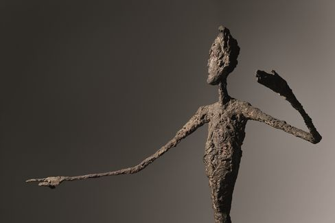 Alberto Giacometti's human-scale bronze sculpture of a pointing man sold for $141.3 million.