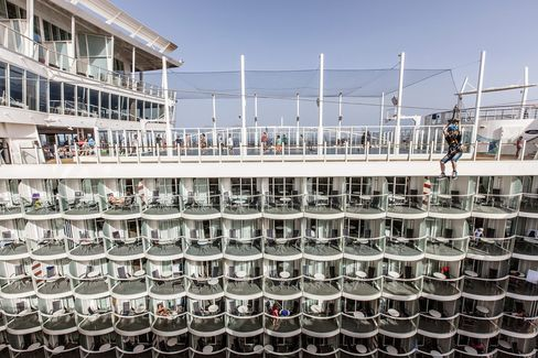 "Suspended nine decks up, a zip line takes guests on a ride across an open-air atrium past some of the ships 2,747 staterooms. Tucked completely inside, 524 staterooms have ""virtual balconies"" that stream real-time video of what you'd see if you had an actual window."