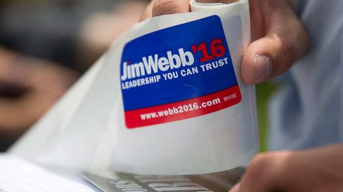 An intern for Jim Webb hands out stickers before Webb speaks to attendees at the Iowa State Fair Soapbox in Des Moines, Iowa, on Aug. 13, 2015.
