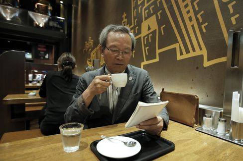 Sadao Sekine drinks a cup of coffee at a cafe bar in Saitama, Japan.  Photographer: Kiyoshi Ota/Bloomberg