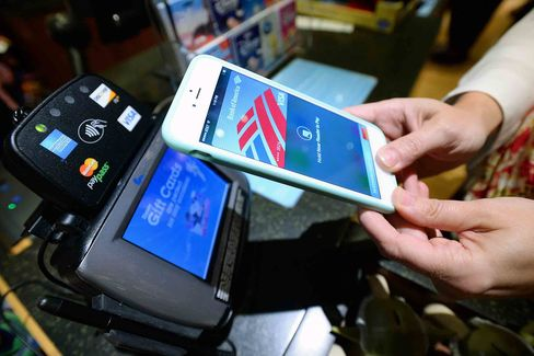 A customer uses Apple Pay at a Disney store in Glendale, Calif.