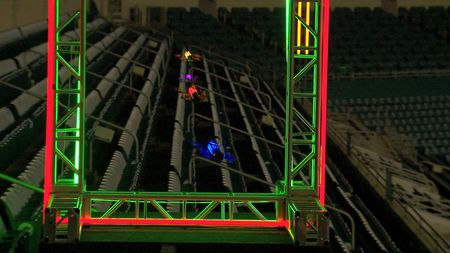 Drones whoosh through a checkpoint in Miami Dolphins stadium.