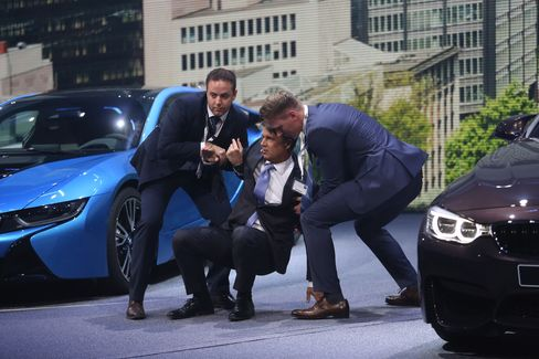 Harald Krueger assisted to his feet at Frankfurt Motor show
