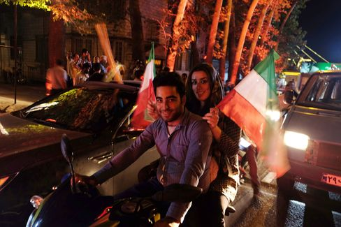 People celebrate after the 5+1 nuclear agreement was announced on Vali Asr Avenue in Tehran, Iran, on July 14, 2015.