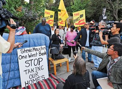 Distressed homeowner Rose Gudiel outside Mnuchin's home last October