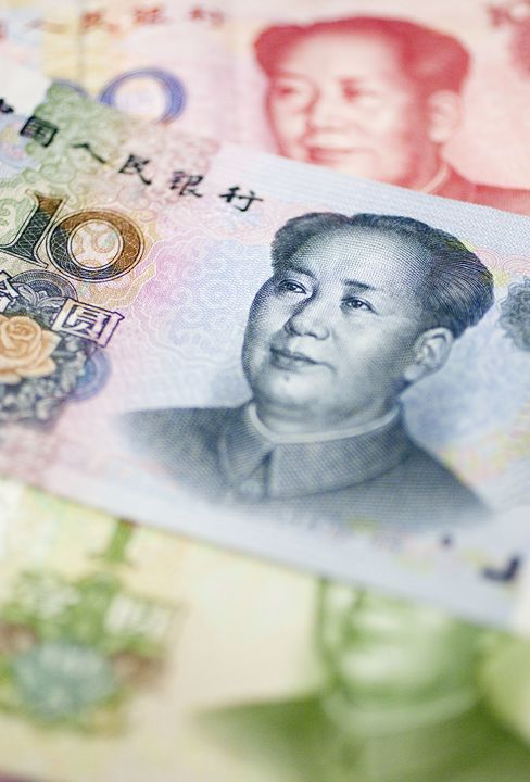 China CEOs Temper Support for Stronger Yuan