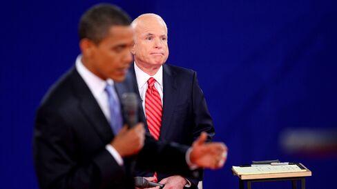 Barack Obama speaks as John McCain listens during a debate in Nashville, Tennessee, on Oct. 7, 2008.