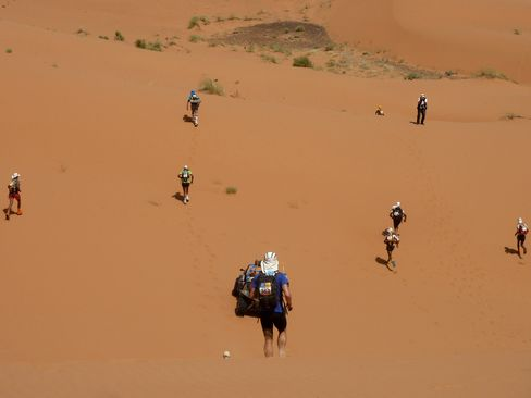 The race leaders pick their way through sand dunes near the end of the 42-kilometer marathon stage – the fifth and final competitive leg of the Marathon des Sables.