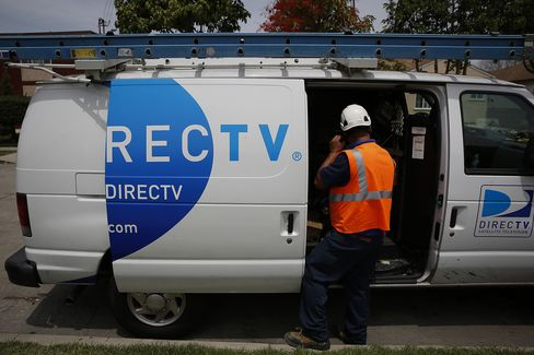 A DirecTV Technician Prepares to Install a Satellite TV Service