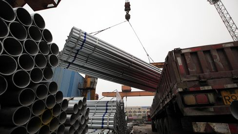 Steel Pipes Are Stockpiled At A Trading Firm