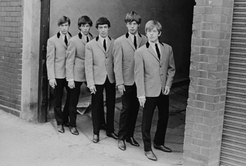 The Rolling Stones in matching jackets and Chelsea boots.