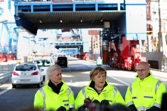 Merkel Hails Open Trade at Hamburg Port Before Pompeo Visit