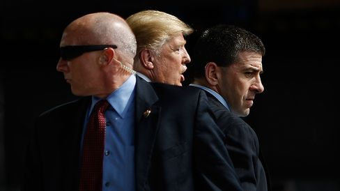 U.S. Secret Service agents surround Donald Trump during a campaign event in Dayton, Ohio, on March 12, 2016.