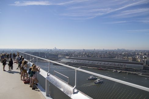 Sightseers take in the city skyline from a viewing platform of the A'DAM Toren