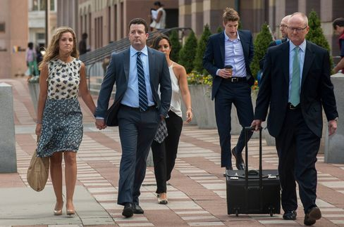 Jesse Litvak, a former managing director at Jefferies & Co., second left, arrives at federal court in New Haven, Conn., on July 23, 2014.