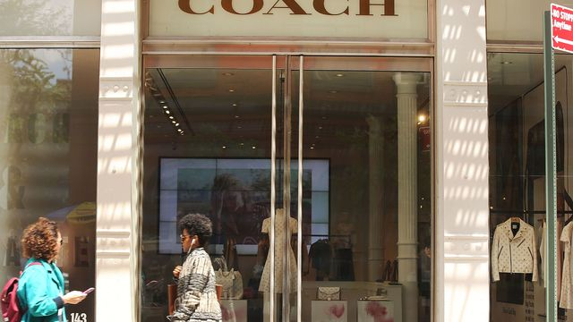 Coach 4Q profit surges on lower costs, topping forecasts