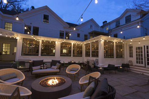 The fire pit roars nightly at Whitehall, in Camden.