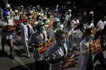 Medical staff and students take part in a protest against the military coup in Mandalay,March 21.