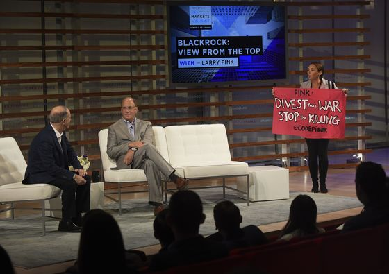 Larry Fink Confronted by Anti-Gun Protesters at Yahoo Summit