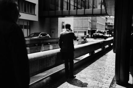 A banker makes a call in Zurich.