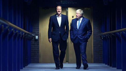 Prime Minister David Cameron, left, and Mayor of London and Parliamentary candidate Boris Johnson at the Conservative party conference on Sept. 29, 2014 in Birmingham, England.
