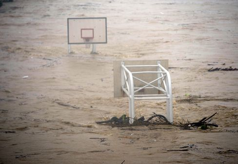 A basket stadium is flooded by the Jingmei river as typhoon Soudelor hits Taipei on August 8, 2015. Typhoon Soudelor battered Taiwan with fierce winds and rain leaving a trail of destruction in its wake.