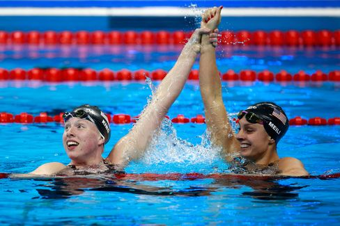 Lilly King (L) of the United States celebrates winning gold with Katie Meili (R) of the United States in the Women's 100m Breaststroke Final on Day 3 of the Rio 2016 Olympic Games.