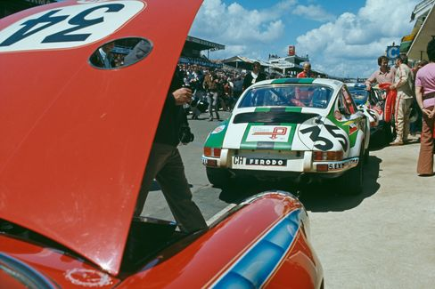 Two Porsche 911 S cars at the 24 Hours of Le Mans, France, 12th-13th June 1971. In the foreground is the car driven by Americans Alain Johnson and Elliot Forbes-Robinson, while number 35 (right) is driven by Sylvain Garant of France and Pierre Greub of Switzerland.
