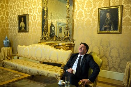 Former Italian Prime Minister Matteo Renzi laughs during an interview at Chigi palace in Rome.