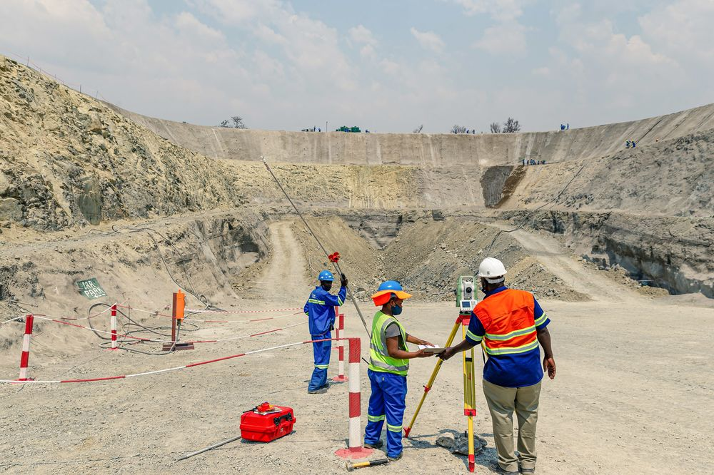 Workers survey a section of theDarwendale platinum mine project, near Harare, Zimbabwe, in Sept.