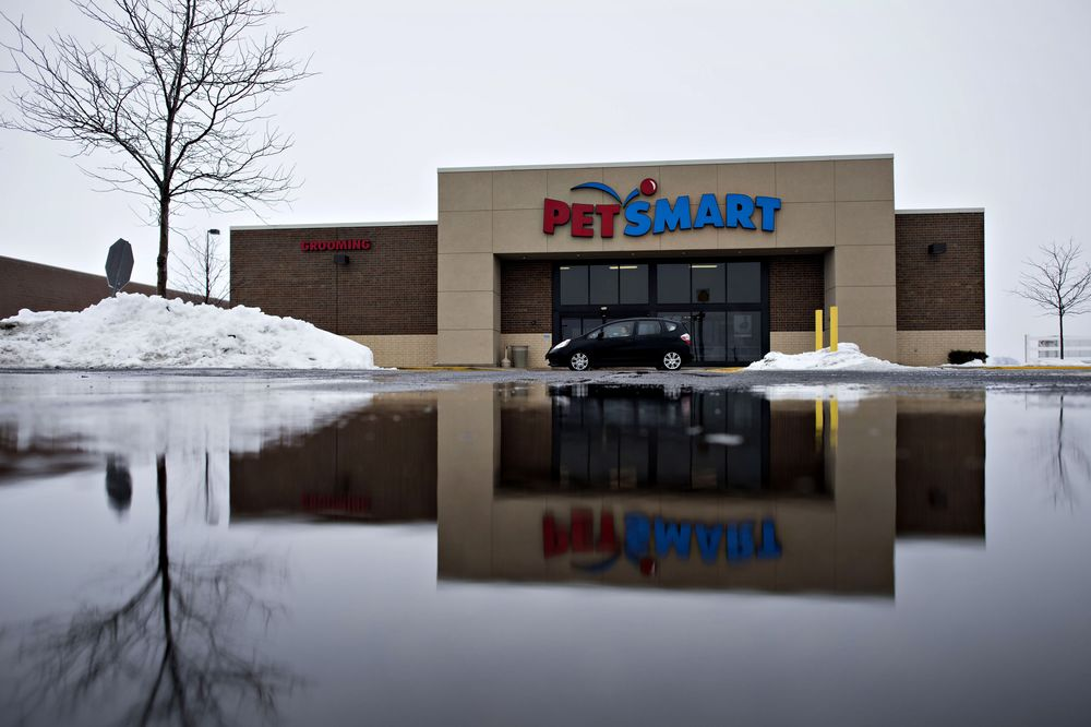 A vehicle drives past a PetSmart Inc. store in LaSalle, Illinois