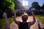 Demonstrators raise their hands in front of the police line at the White House as they protest the death of George Floyd at the hands of Minneapolis Police in Washington, D.C. on May 31, 2020.