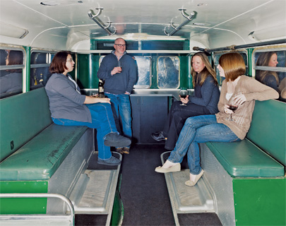 Bailey employees gather in the bus—which is stripped of combustible materials—for more private conversations