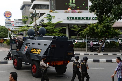 A police armored vehicle stands near the site of an explosion in Jakarta.