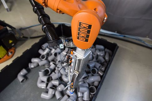 A Scape Technologies 3D camera sits on a Kuka KR 16 robotic arm at the robot collision testing facility in the Fraunhofer Institute in Magdeburg, Germany.