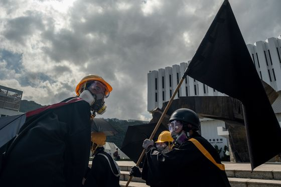 Hong Kong Police Security Unit Arrests Eight Over Campus Protest