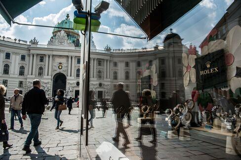 Pedestrians Pass a Store in Vienna